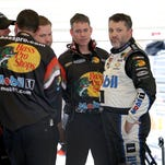 Tony Stewart talks to his crew following the first practice for the Crown Royal Jeff Kyle 400 at the Brickyard Friday, July 24, 2015, morning at the Indianapolis Motor Speedway.