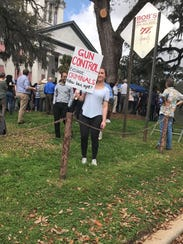 Melanie Clark, an 18-year-old high school senior from Tallahassee, held a small counter-demonstration at the Florida Capitol on Feb. 21.