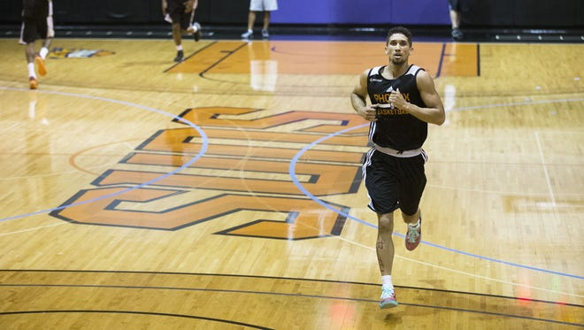 Colorado guard Askia Booker crosses the court during a timed running drill at the Phoenix Suns draft workout on Tuesday, May 26, 2015 at US Airways Center in Phoenix, AZ.