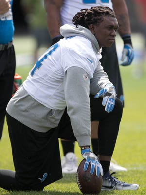 Lions defensive end Ziggy Ansah watches drills during organized team activities Wednesday, May 31, 2017 at Allen Park.