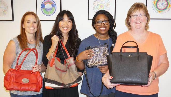 : Members of Bloomingdale's Short Hills and Bridgewater stores lend a helping hand to inspect and price this year's collection of donated handbags for the annual JBWS fundraiser Old Bags Luncheon®. They are (l-r) Genine Carlson, Visual Merchandise Manager and Amy Catena, Group Manager, both of Bloomingdale's Bridgewater with Marlie Massena, Public Relations Manager for Bloomingdale's Short Hills and Bridgewater, and volunteer Old Bags Luncheon® Committee Chair, Linda Horn.