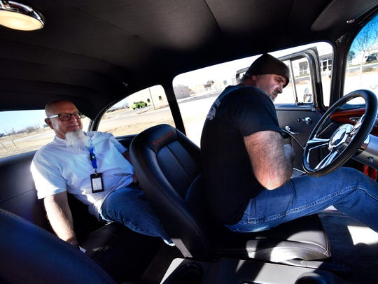 Abilene Reporter-News Editor Greg Jaklewicz sits in back as Jack Young sits in the driver's seat of a 1955 Chevrolet Bel Air 210, taking the car for a spin around the block Wednesday.