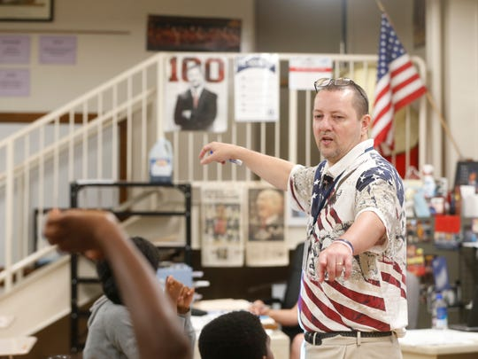 History teacher Brent Wooters teaches a lesson on the