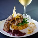 Jerk-spiced grouper cheeks atop mofongo and haricot vert with a pineapple and wild berry crush, garnished with toasted coconut, plantain chip and pork cracklins is a dish worth trying at Islands Fish Grill in Indialantic.