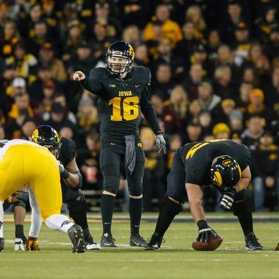 Iowa junior quarterback CJ Beathard points out the