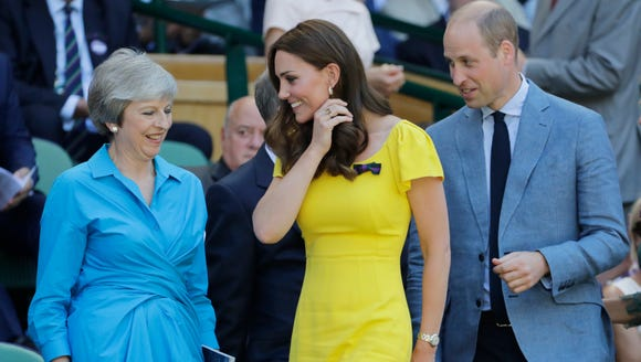 Will and Kate take their seats near Prime Minister Theresa May, left, and her husband Philip May.