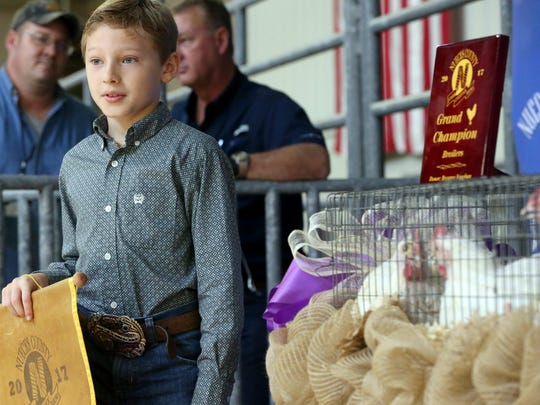 John Hartsell from Flour Bluff/ Padre Island 4-H displays his Grand Champion Broilers during the 82nd Annual Nueces County Junior Livestock Show and Sale on Saturday, Jan. 21, 2017, at the Richard M. Borchard Regional Fairgrounds in Robstown.