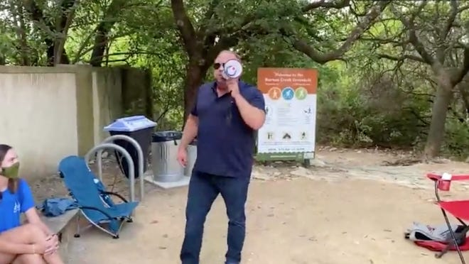 In a video captured at the Barton Creek greenbelt, Austin-based conspiracy theorist Alex Jones uses a megaphone to yell at Austin employees and visitors.