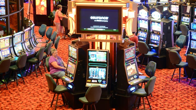 A guest plays slots at the Oneida Casino.
