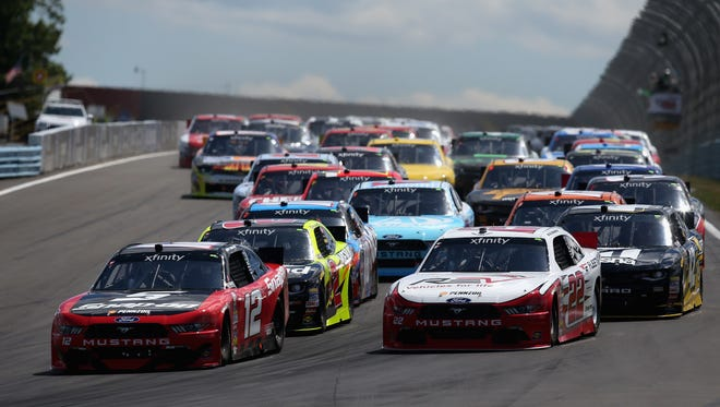 Joey Logano (12) and Brad Keselowski lead the field during the NASCAR Xfinity Series Zippo 200 at The Glen on Saturday at Watkins Glen International.