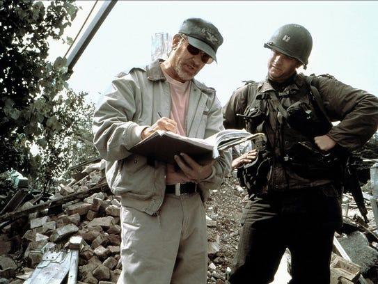 "Steven Spielberg directs Tom Hanks on the set of ""Saving"