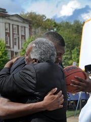 Vanderbilt Athletic Director David Williams gets a hug from  former Vanderbilt basketball star Festus Ezeli of the Golden State Warriors on Saturday, Sept. 12, 2015, in Nashville.