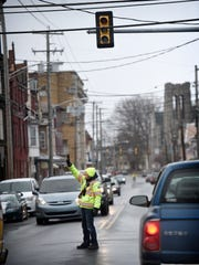 Fire-policeman Justin Hinkle directs traffics at 5th and Lehman after a transformer exploded and took out electricity and street lights in the immediate area.