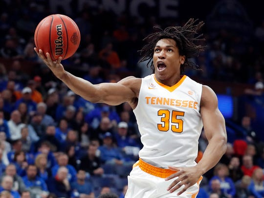 Tennessee forward Yves Pons scores against Kentucky during the first half of an NCAA college basketball championship game at the Southeastern Conference tournament Sunday, March 11, 2018, in St. Louis. (AP Photo/Jeff Roberson)