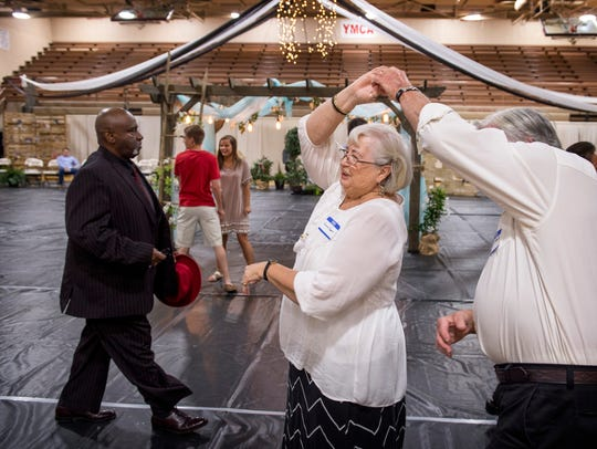 Ron and Bernie Cooper jitterbug to a tune at the senior