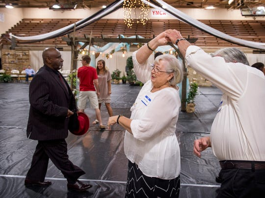 Ron and Bernie Cooper jitterbug to a tune at the senior citizen prom at Henderson County High School Monday morning. The couple have been dancing partners since they got married in 1960. Both graduated in 1958, but at different Henderson high schools. Bernie at Holy Name and Ron at City High.