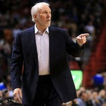 Head coach Gregg Popovich of the San Antonio Spurs looks on during a game against the Miami Heat at American Airlines Arena on Tuesday, Feb. 9, 2016, in Miami.