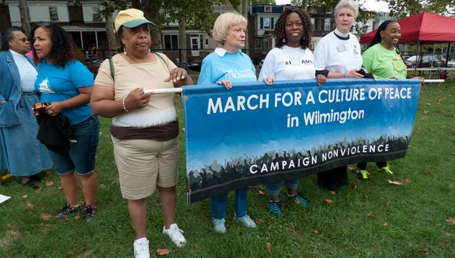 Marchers gather in Wilmington's Judy Johnson Park for the 2016 March for a Culture of Peace.