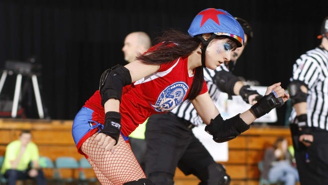 Panty Raiders jammer Ashley Larson clears the pack during a past Cherry City Derby Girls bout.
