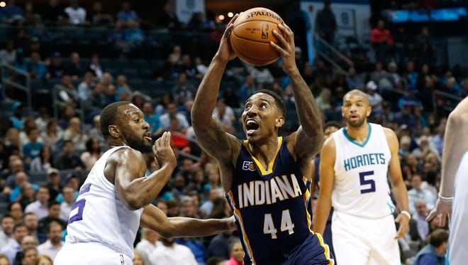 Indiana Pacers guard Jeff Teague (44) goes up for a shot against Charlotte Hornets guard Kemba Walker (15) in the first half at Spectrum Center.