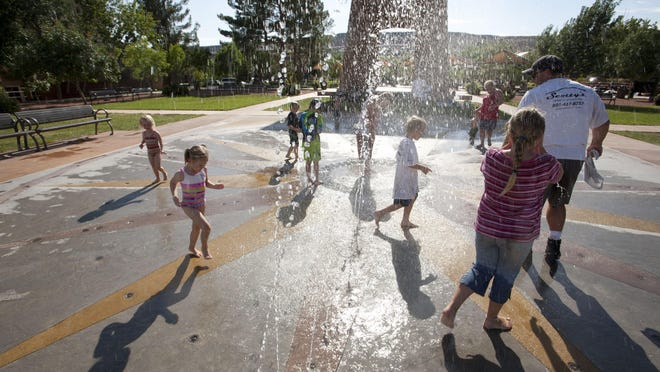 Children and parents alike romp through the waters of the splash pad in Town Square Park in St. George. As the temperatures creep higher – above 100 – more people can be susceptible to heat-related illnesses, especially young people, seniors and people who aren't used to that type of heat.