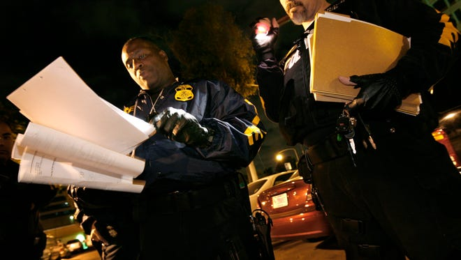 Derrick Taylor, Immigration and Customs Enforcement supervisor of fugitive operations for deportation, gives a briefing to his team about suspects before a pre-dawn raid in Santa Ana, Calif., on Jan. 17, 2007.