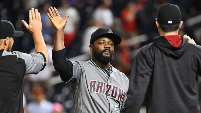 Diamondbacks closer Fernando Rodney celebrates with teammates after earning a save against the Nationals at Nationals Park on May 2.