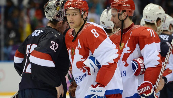 USA goalie Jonathan Quick (32) shakes hands with Russia forward Alex Ovechkin (8) after Saturday's American victory. Most of the players on both teams know each other unlike in 1980.