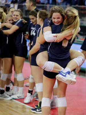 Lake Country Lutheran's Sarabeth Pankow leaps into the arms of Jennifer O'Keefe after the Lightning defeated Eau Claire Regis for the Division 3 title at the WIAA state girls volleyball tournament Saturday in Ashwaubenon.