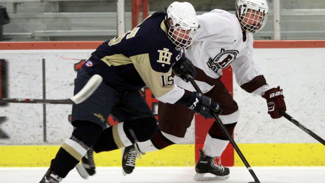 Cameron Cotter (15) and the Indian Hills ice hockey team have clinched first place in the Big North Liberty Stars Division.