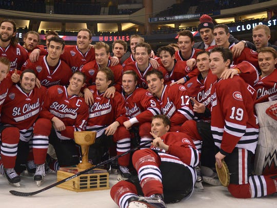 St. Cloud State teammates pose beside the North Star