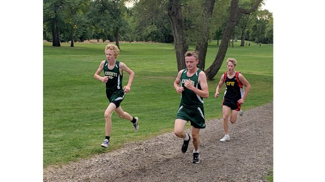 Running at the Sanborn Golf Course (Wabasso meet) Joshua Hagen (left) and Nate Fliszar came in first and second.