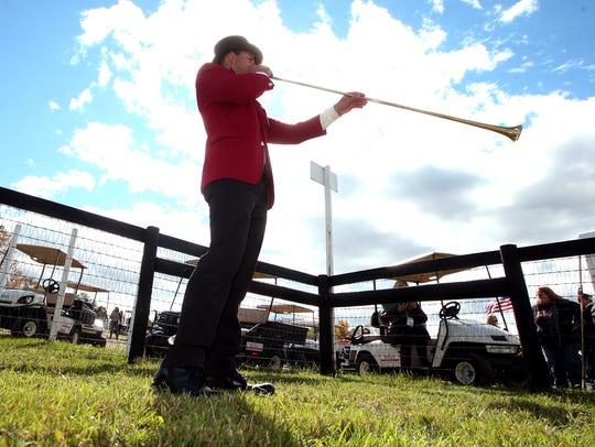Bugler Mark Tarentino warms up at the 95rd annual Far