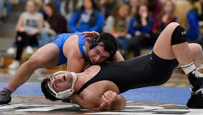 Foley's Dakota McIver rolls Milaca's Cole Barsody on his back and takes the win during the 170-pound match at Foley High School.