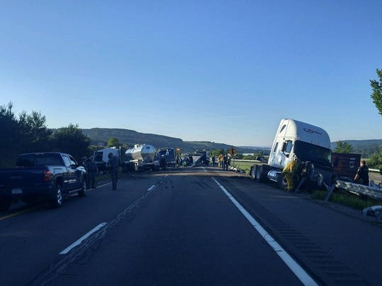 State troopers investigate the crash involving two tractor trailers Monday morning on Interstate 81 in Marathon.