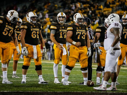 Wyoming center Chase Roullier (73) said one play by