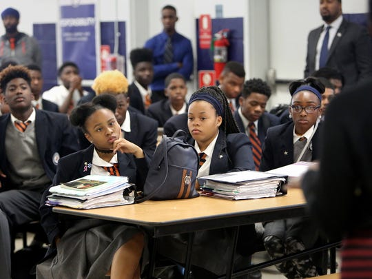 November 9, 2016 - Freedom Preparatory 9th graders Summer Stepeney (left) and Terika Dean listen to principal Kristle Hodges-Johnson during a school discussion on the results of the Presidential election.