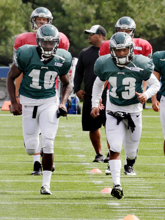 Philadelphia Eagles wide receiver Jeremy Maclin (18) runs with teammate Damaris Johnson (13) during an NFL football training camp scrimmage of the New England Patriots and Eagles in Foxborough, Mass., Tuesday, Aug. 12, 2014. (AP Photo/Charles Krupa)