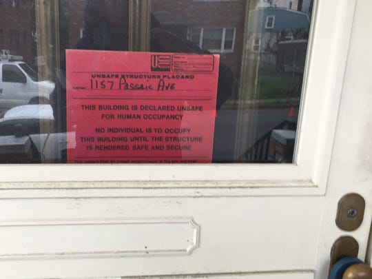 A sign on a Passaic Avenue home in Linden indicating it is unfit for human occupancy following a report of apparent carbon monoxide exposure.