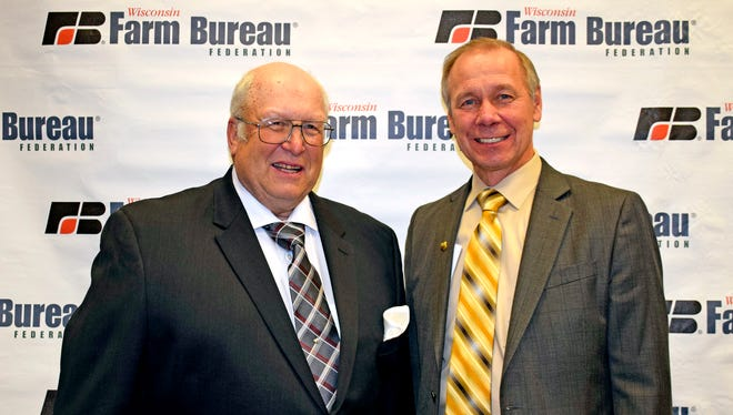 Dave Kruschke collected the WFBF's highest member award. He is joined by WFBF President Jim Holte.