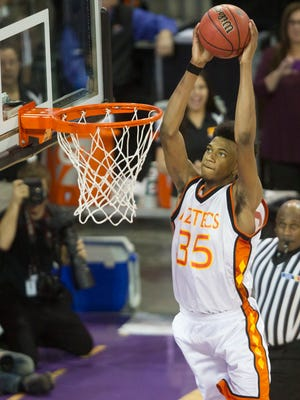 Corona del Sol's Marvin Bagley III goes up for a dunk to close out Chaparral at GCU Arena in Phoenix on Feb. 28, 2015.