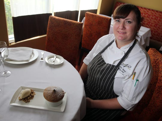 Kelly West, pastry chef at Restaurant Nicholas, shows her plum souffle.