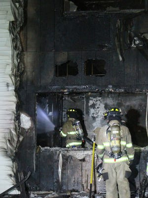 Purchase firefighters with help from several central Westchester departments battle a 4-alarm fire in a dormitory at Purchase College SUNY Sunday night Sept. 4, 2016. All the students living in the dorm were able to escape uninjured.
