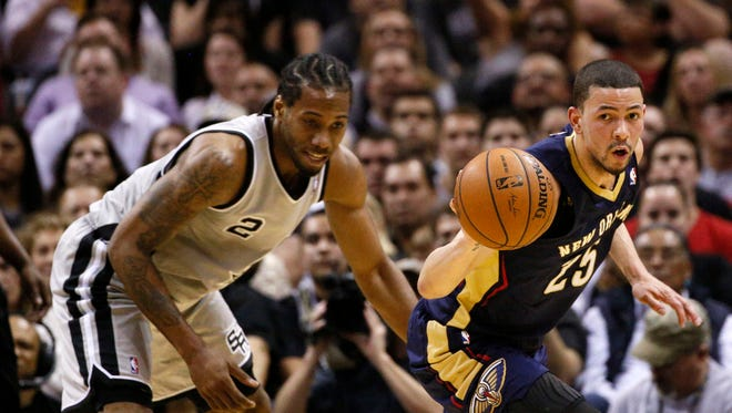 San Antonio Spurs forward Kawhi Leonard (2) has the ball stolen by New Orleans Pelicans guard Austin Rivers (25) during the first half at AT&T Center.
