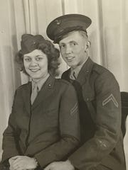 """Audrey Wells poses with her brother Elmer """"Buzz"""" Simmons in the Marine Corps uniforms during World War II"""
