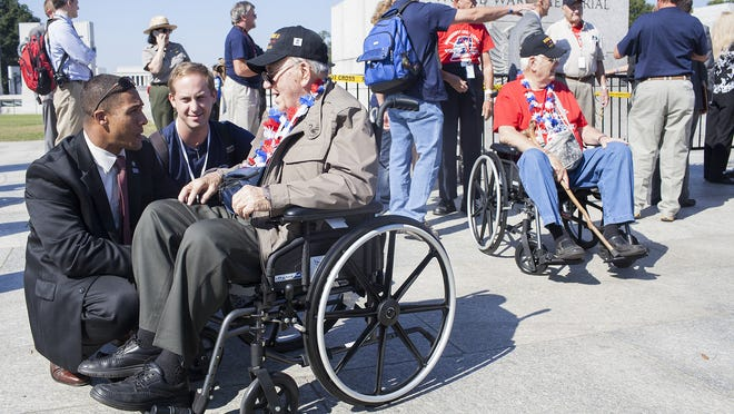 Verice Bennett, left, and Hunter Lipscomb welcome veteran Oscar L. Russell to the World War II Memorial on Oct. 1 during a visit organized by the Mississippi Gulf Coast Honor Flight in Washington, D.C.