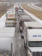A long backup forms on westbound I-96 due to a multi-vehicle