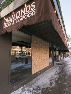A vehicle drove into the Diamond Steak and Seafood restaurant Sunday, Dec. 24, and a window remains boarded up Wednesday, Dec. 27, 2017.