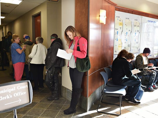 Citizens wait in line at the Fort Collins Municipal Court on Thursday, April 6, 2017.