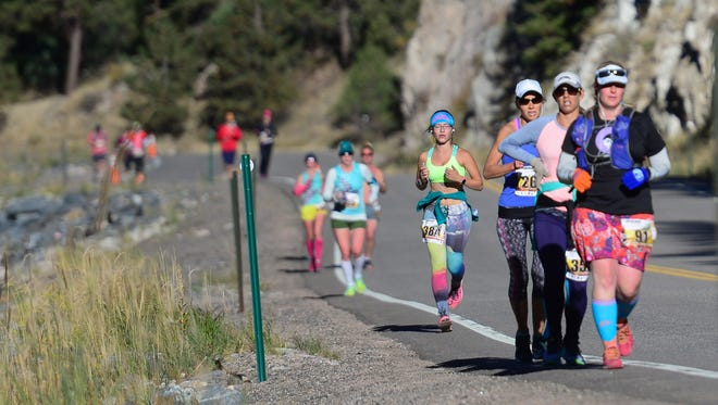 Runners participate in the Loveland Marathon from Estes Park through the Big Thompson Canyon Sunday, September 25, 2016.